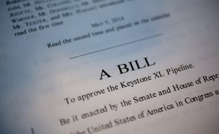 A copy of S. 2280, a bill which would approve the Keystone XL Pipeline, is arranged for a photograph in Washington, D.C., U.S., on Monday, Nov. 17, 2014. U.S. Senator Mary Landrieu and other supporters of a bill to approve TransCanada Corp.'s Keystone XL pipeline are still one vote shy of the 60 needed as time runs short before tomorrow's vote. Photo by Andrew Harrer/Bloomberg via Getty Images