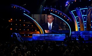 President Barack Obama speaks onscreen during the Latin Grammy Awards in Las Vegas. Photo by Ethan Miller/Getty Images