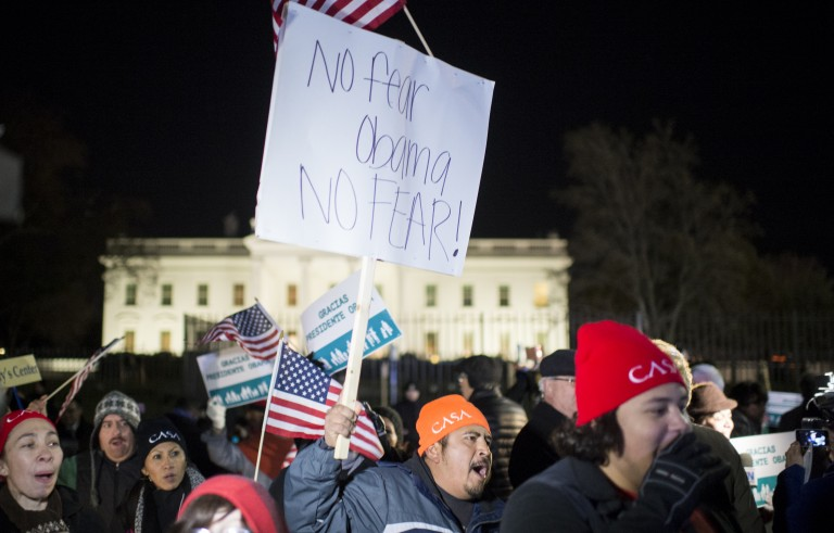 Immigration reform activists in front of the White House march and chant following President Barack Obama's speech on his executive action on immigration policies on Thursday, Nov. 20, 2014. Photo By Bill Clark/CQ Roll Call
