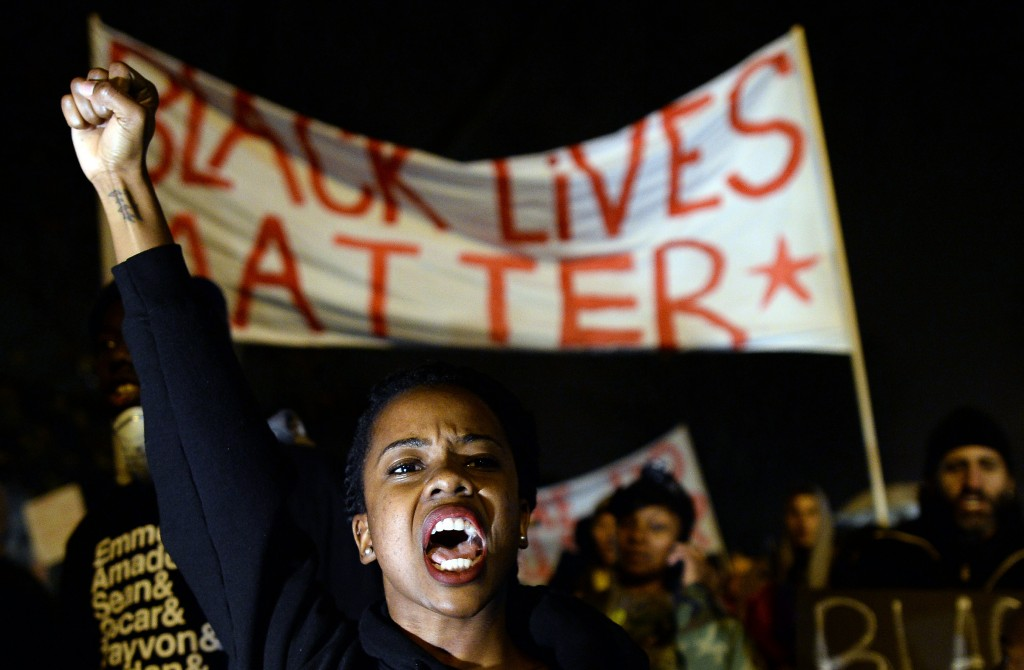 Demonstrators marched peacefully through the streets of St. Louis on Sunday anticipating a decision from the grand jury in the shooting of teenager Michael Brown by Ferguson police officer Darren Wilson. Photo by Jewel Samad/AFP/Getty Images