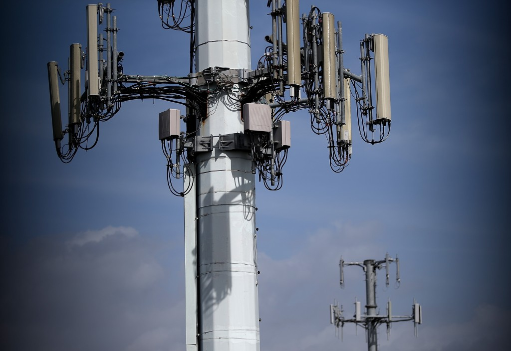 A view of cellular communication towers on March 6, 2014 in Emeryville, California. Photo by Justin Sullivan/Getty Images