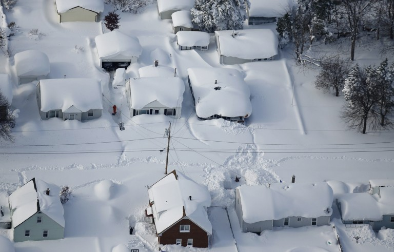 The angular roofs of houses in West Seneca, New York, turned into lumps of snow after a Tuesday night snow storm in the region. Photo by Derek Gee/Buffalo News