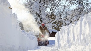 Paul Lorenzo snowblows a path in Orchard Park, a suburb of Buffalo, New York. With some areas hit by five feet of snow and more forecast tonight through early Friday, snow crews and residents face a daunting task of clearing snow. Harry Scull Jr./Buffalo News