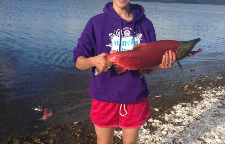 Sassa Williams, 18, practices Yup'ik traditions with her family in Dillingham, Alaska, including subsistence fishing for salmon.  Photo Courtesy: Sassa Williams