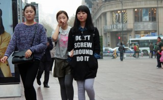 Friends walk through a shopping area of Shanghai, China, on Nov. 22. Photo by Larisa Epatko