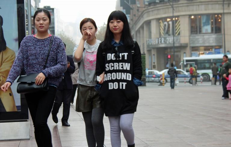 Friends walk through a shopping area of Shanghai, China, on Nov. 22. Photo by Larisa Epatko