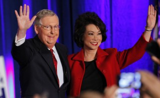 Mitch McConnell (R-KY) waves to supporters with his wife, former United States Secretary of Labor Elaine Chao, at his midterm election night rally in Louisville, Kentucky, November 4, 2014. Photo by John Sommers II/Reuters