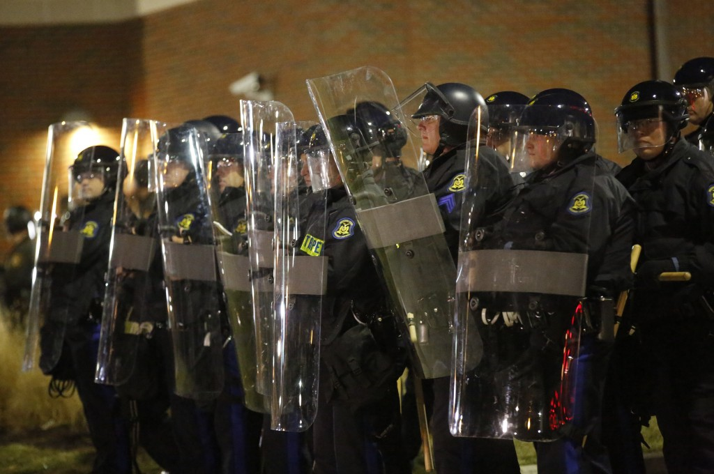 Missouri State Troopers in riot gear stand in formation outside the Ferguson Police Department in Ferguson, Missouri. Photo by Jim Young/REUTERS