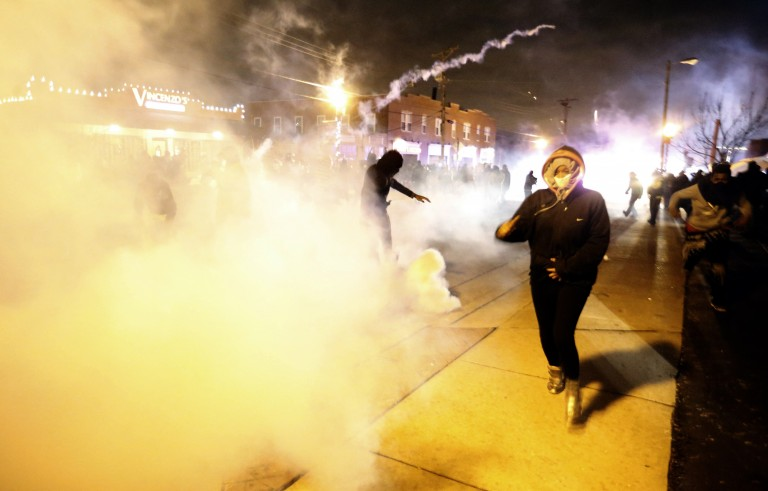 Protesters run from a cloud of tear gas in Ferguson, Missouri. Photo Jim Young / REUTERS