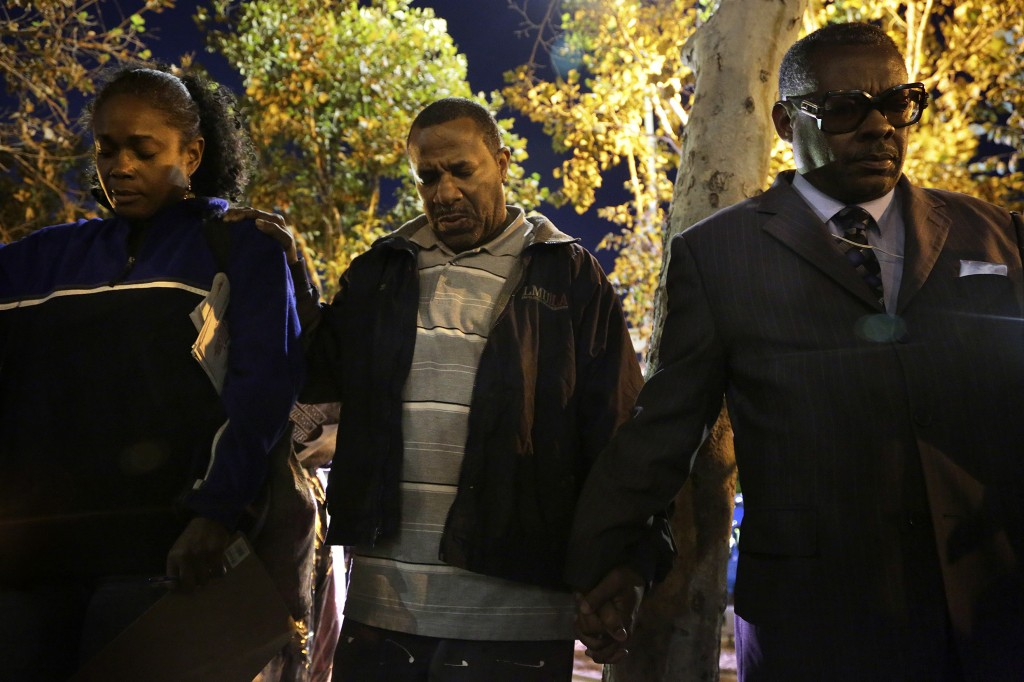 People hold hands while praying during a demonstration in Los Angeles, California, following the grand jury decision in the shooting of Michael Brown in Ferguson, Missouri. Photo by Jonathan Alcorn / REUTERS