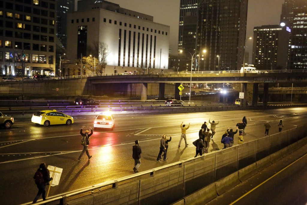 A group of demonstrators walk onto Interstate 5 following the grand jury decision in the Ferguson, Missouri shooting of Michael Brown, in Seattle, Washington November 24.  Photo by Jason Redmond