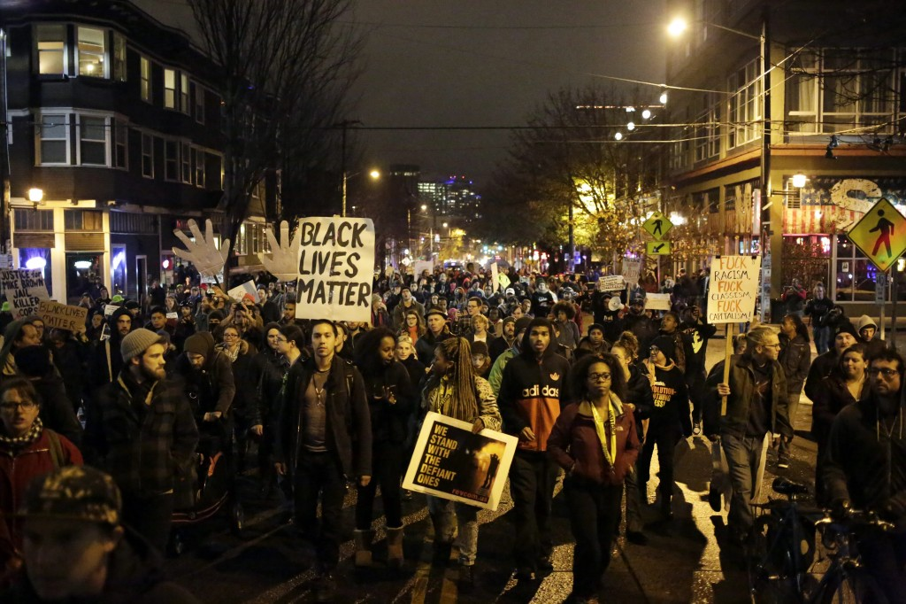Demonstrators march through the streets following the grand jury decision in the Ferguson, Missouri shooting of Michael Brown, in Seattle, Washington November 24, 2014.  REUTERS/Jason Redmond