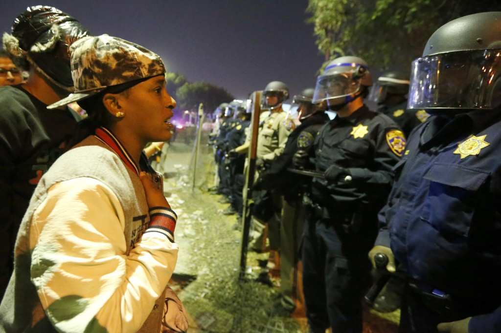 A protester talks to police during a demonstration in Los Angeles, California on November 24. REUTERS/Lucy Nicholson