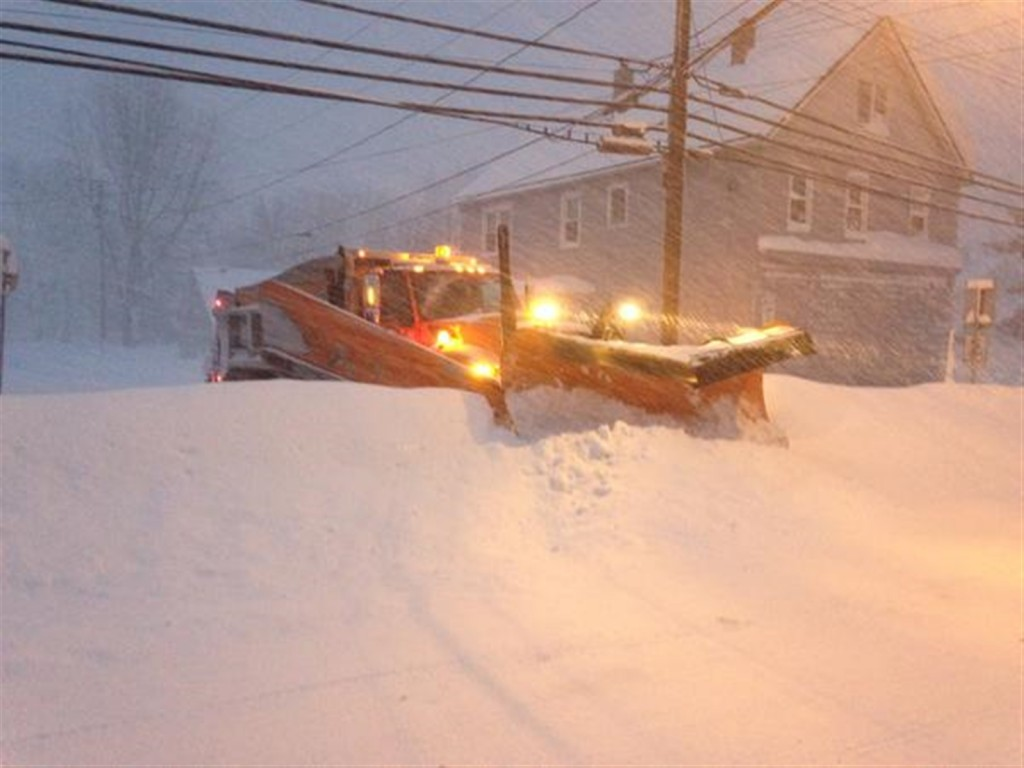 A plow pushes through snow in Lancaster, NY. Some areas of western New York received 5 feet of snowfall. With more to come between Wednesday and Friday, clearing the streets has become a daunting task. Photo courtesy: John Hickey/Buffalo News