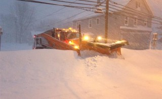 A plow pushes through snow in Lancaster, NY. Some areas of western New York received 5 feet of snowfall. With more to come between Wednesday and Friday, clearing the streets has been a daunting task. Photo courtesy: John Hickey/Buffalo News