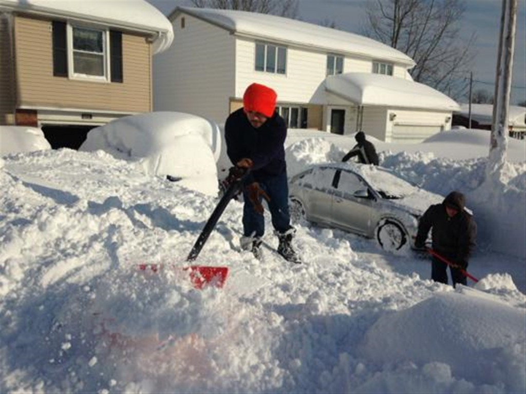 The Porto family digs out their driveway in Depew, NY. Photo courtesy: John Hickey/Buffalo News