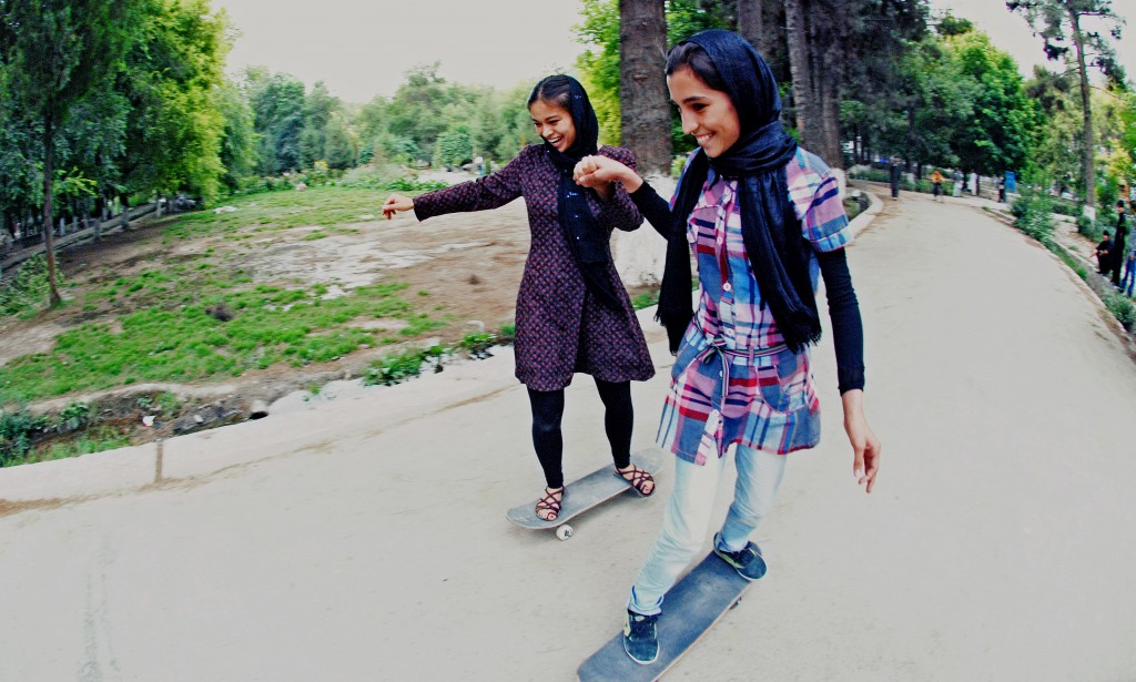 Skateistan youth leader Madina Khsrawy teaches another girl how to