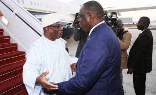 Senegal's president Macky Sall (right) welcomes Mali's president Ibrahim Boubacar Keita upon his arrival at Dakar airport, on November 29, 2014, on the opening day of the 15th summit of the International Organisation of French-Speakers. Keita announced at the summit Mali was free of Ebola. Credit: Getty Images