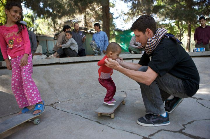 Skateistan's founder and executive director Oliver Percovich with possibly the youngest girl skateboarder in Afghanistan. Photo courtesy of Skateistan