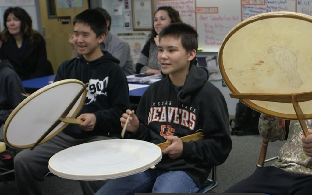 Trevor Akelkok and Jesse Noden are drumming as their class practices a Yup'ik song and dance at Dillingham High School in Dillingham, Alaska. Photo by: Mike Fritz/PBS NewsHour