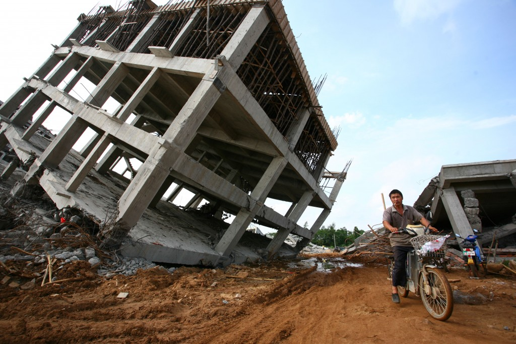 A Precarious Position Illegal buildings are demolished by the local government in Haikou, China, on Aug. 6. (ChinaFotoPress/Getty Images)