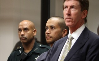 George Zimmerman (center) appeared for a bond hearing with his attorney Mark O'Mara (right) at the John E. Polk Correctional Facility April 12, 2012 in Sanford, Florida, a day after he was charged with second degree murder in the fatal shooting of 17-year-old Trayvon Martin. Photo by Gary Green/The Orlando Sentinel-Pool/Getty Images