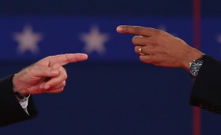 The Democratic National Committee has announced locations for six candidate debates for the upcoming 2016 presidential election. Here, Republican presidential candidate Mitt Romney and U.S. President Barack Obama talk to each other during a town hall style debate at Hofstra University October 16, 2012 in Hempstead, New York. Photo by Spencer Platt/Getty Images
