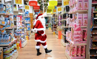 A Santa Claus walks through a toy store in Lille, northern France. According to a new poll, a majority of non-religious Americans say they partake in gift-giving over the holidays. Photo Philippe Huguen/AFP/Getty Images