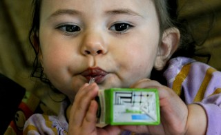 One-year-old Jaeliece Ortiz enjoys some of the food (fruit juice) her mother (Rebecka Ortiz) just brought home after shopping with her SNAP (food stamps) card. About a fifth of SNAP recipients are eligible for grant-funded training programs designed to help send them back to work. Photo by Michael S. Williamson/The Washington Post via Getty Images