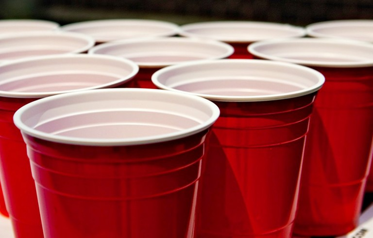 Solo cups lined up for popular college drinking game beer pong. More than 1,800 students die each year from alcohol related incidents in the U.S. Photo by Flickr user Yogma.