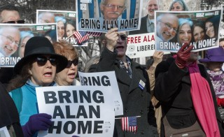 Protesters call for the release of U.S. citizen Alan Gross, who is imprisoned in Cuba, at a rally in Lafayette Park Dec. 3, 2013, across the street from the White House in Washington, D.C. Photo by Paul J. Richards/AFP/Getty Images