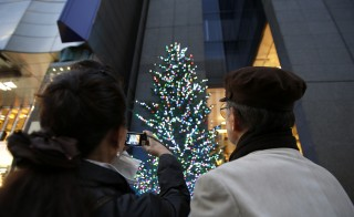Getting through the holidays can be emotionally draining, especially when you're the caretaker for a loved one. Taking the time acknowledge what you're grateful for can help you focus on the positives of the season. Photo by Kiyoshi Ota/Bloomberg via Getty Images