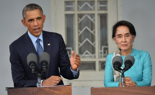 U.S. President Barack Obama and Myanmar's opposition leader Aung San Suu Kyi, R, speak during a press conference at her residence in Yangon on November 14, 2014.  Obama began talks with Suu Kyi, in a show of support for the opposition leader as the nation turns towards elections next year with uncertainty over the direction of reforms. Photo by Mandel Ngan/AFP/Getty Images
