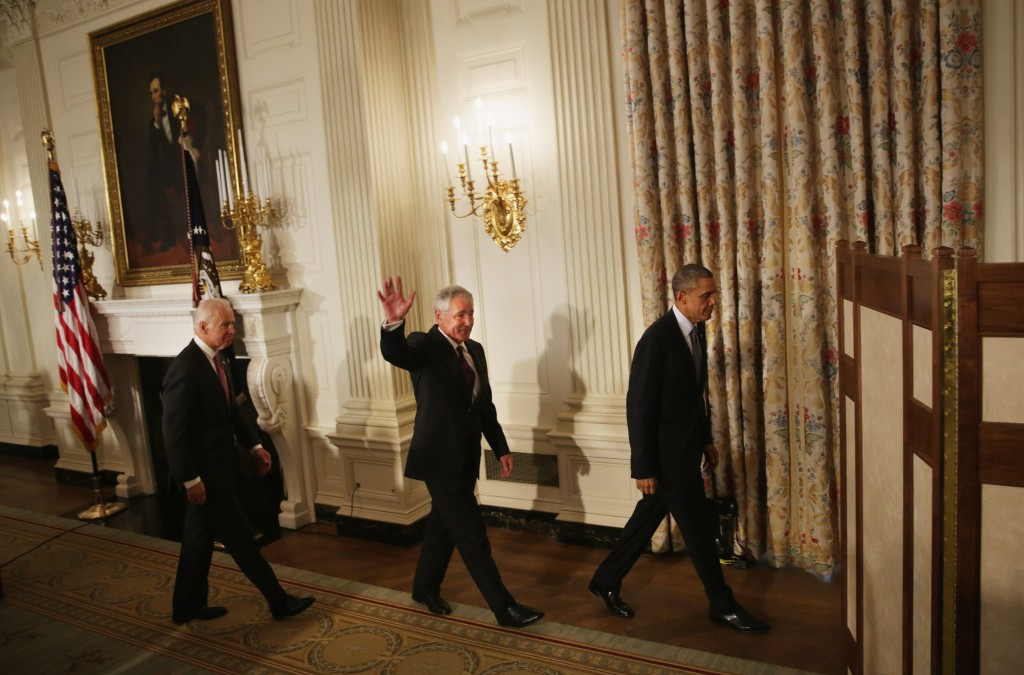 President Barack Obama (R), Secretary of Defense Chuck Hagel (2nd L) and Vice President Joseph Biden (L) leave after a press conference announcing Hagel's resignation in the State Dining Room of the White House November 24, 2014 in Washington, DC. Photo by Alex Wong/Getty Images