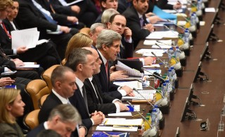 U.S. Secretary of State John Kerry (center) addresses a meeting of the 60-member coalition trying to crush the Islamic State militant group at the NATO headquarters in Brussels on Dec. 3. Photo by Emmanuel Dunand/AFP/Getty Images