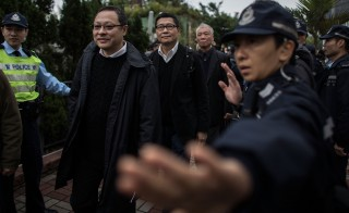 "Benny Tai Yiu-ting, Chan Kin-man and the Rev. Chu Yiu-ming (left-right), the three leaders of Hong Kong's ""Occupy Central"" movement, surrender themselves to police on Dec. 3. Photo by Lam Yik Fei/Getty Images"