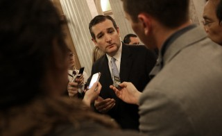 U.S. Sen. Ted Cruz (R-TX) speaks with reporters after the U.S. Senate voted to approve a $1.1 trillion omnibus funding bill December 13, 2014 in Washington, DC. Despite Cruz's efforts to delay the vote due to objections with U.S. President Barack Obama's immigration orders, the Senate approved the funding and will avoid a government shutdown. (Photo by Win McNamee/Getty Images)