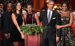Malia Obama, Sasha Obama, U.S. President Barack Obama, and First Lady Michelle Obama speak onstage at TNT Christmas in Washington 2014 at the National Building Museum on December 14, 2014 Photo by Theo Wargo/WireImage