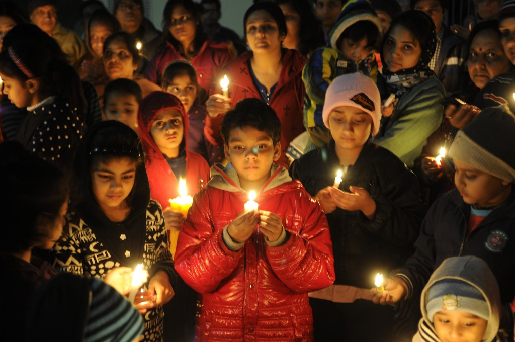 Children and their parents in Noida, India, light candles for the victims of the Taliban attack on the school in Peshawar, Pakistan, on Dec. 17. Photo by Burhaan Kinu/Hindustan Times via Getty Images