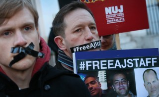 Journalists and supporters demonstrate outside the Egyptian embassy as they call for the release of Al Jazeera reporters on December 29, 2014 in London, England.