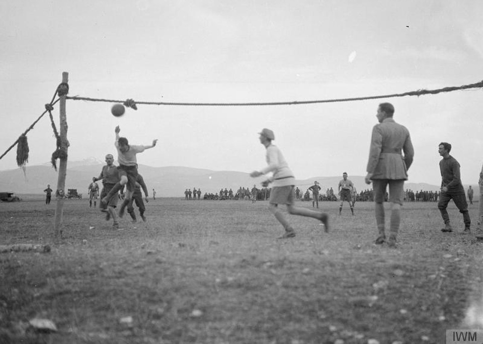 1916. A handmade football net is setup by soldiers for an inter-company match on the Balkan Front on Christmas Day. Imperial War Museum via Open University