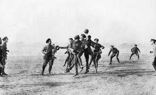 The British Army 26th Divisional Ammunition Train get involved in a football match on Christmas Day in Greece in 1915. Photo courtesy of Imperial War Museum