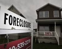 A foreclosed home for sale in Winchester, VA, on May 28, 2009.  Mortgage delinquencies and foreclosures rose to records in the first quarter and home-loan rates jumped to the highest since March as the government's effort to revive the housing market lost momentum. A bank was offering unusual 100 percent financing for the home.  Photographer:  Jay Mallin / Bloomberg News. Jay Mallin/Bloomberg via Getty Images