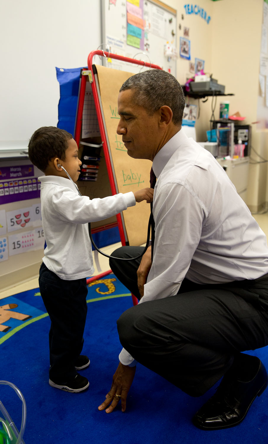 A young boy checks the President's heartbeat during a visit to a classroom at Powell Elementary School in Washington, D.C. Official White House photo by Pete Souza.