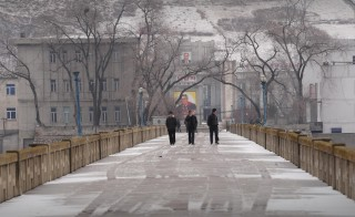 Visitors walk across a bridge over the Tumen river from North Korea to the town of Tumen in China's Jilin province on March 21, 2009. Credit:  Peter ParksAFP/Getty Images.