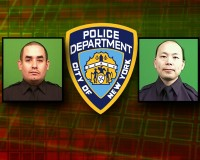 OFFICERS DOWN   NYPD police shield and chips of 2 slain officers monitor