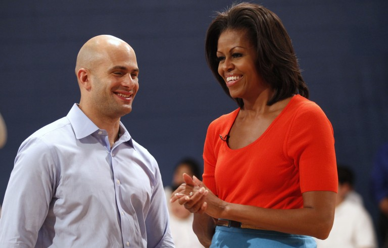 "First lady Michelle Obama talks with assistant White House chef Sam Kass during a taping of the TV cooking show ""Top Chef""  in Dallas, Texas February 10, 2012. Photo by Kevin Lamarque/Reuters"