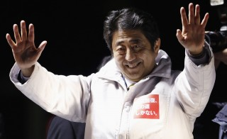 Japan's Prime Minister Shinzo Abe, leader of the ruling Liberal Democratic Party (LDP), waves his hands to voters atop a van during a campaign for the Dec. 14 lower house election in Saitama, north of Tokyo December 12, 2014. Photo by Yuya Shino/Reuters