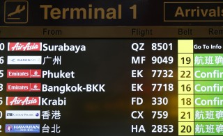 A flight information signboard shows the status of AirAsia flight QZ8501 from the Indonesian city of Surabaya to Singapore at Changi Airport in Singapore Dec. 28, 2014. The airliner carrying 162 people from Surabaya, Indonesia, to Singapore crashed into the Java Sea about halfway through the flight. Rescuers began retrieving bodies from the last known coordinates of the flight. Photo by Edgar Su/Reuters