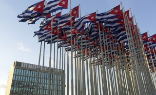 Cuban flags fly beside the United States Interests Section in Havana (USINT), in Havana